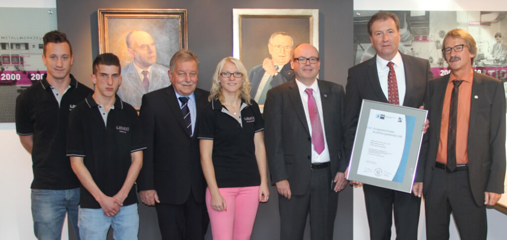 Awarding of certificate, from left to right: Kai Anton Schiebel, Fabian Luz, Günther Graef (Human Resources Manager), Irina Elscheidt, Tobias Graff (Manager of Human Resources Development and Training), Martin Keppler (Managing Director of IHK Nordschwarzwald) and Frank Diez (Chairman of the executive board)